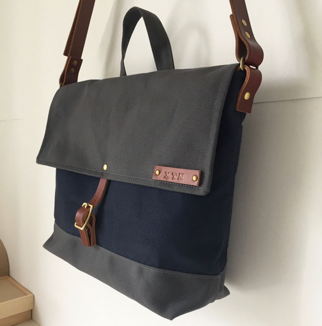 modern-coup-waxed-canvas-leather-bags-courier-bag-blue-grey-hung